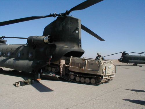 86-01669 in Afghanistan practicing cargo loading maneuvers.