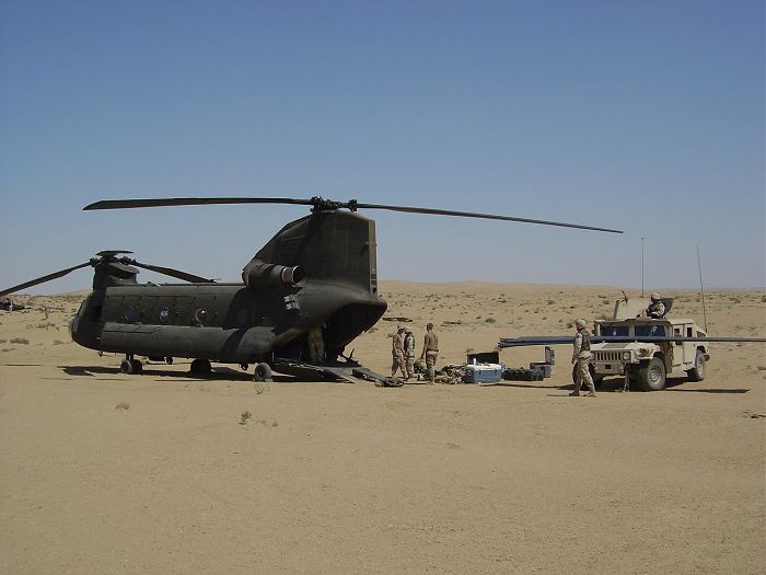 93-00928 assisting with the recovery of a downed UH-60 Blackhawk helicopter in the desert of Iraq.
