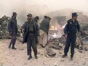 Afghans attempt to extinguish the remains of a U.S. military CH-47D Chinook helicopter which crashed during a dust storm in Ghazni province, 120 km southwest of the capital of Kabul in this image taken from television footage on 6 April 2005.